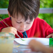 Three years old boy painting with brush — Stock Photo #10648080