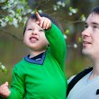 Father and his little son in spring park — Stock Photo