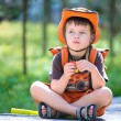 Stock Photo: Portrait of a little boy in summer forest