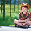 Portrait of a little boy in summer forest — Stock Photo