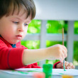 Little boy painting with brush — Stock Photo #10649676