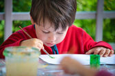 Three years old boy painting with brush — Stock Photo