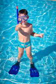 A little boy standing in a pool — Stock Photo