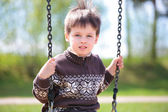 Small child on swing — Stock Photo