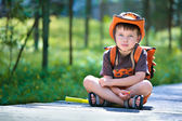 Portrait of a little boy in summer forest — Stockfoto