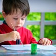 Cute little boy painting with brush — Stock Photo #8905939