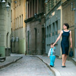 Mother and her little son walking in city — Stock Photo #8906041