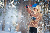 Portrait of a little boy playing outdoors in a winter forest — Stock Photo