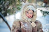 Portrait of a little boy in winter forest — Stock Photo
