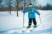 Cute little boy skiing on cross — Stock Photo