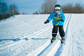 Cute little boy skiing downhill — Stock Photo