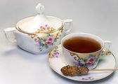 Cup of tea with sugar bowl — Stock Photo