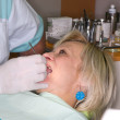 Lady under dental examination — Photo