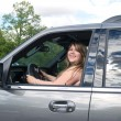Young lady in car — Foto de Stock