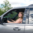 Young lady in car — Stock fotografie