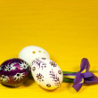 Three easter eggs and iris — Stock Photo