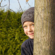 Stock Photo: Girl playing hide-and-seek