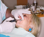 Mature lady receive local anesthesia — Stock Photo