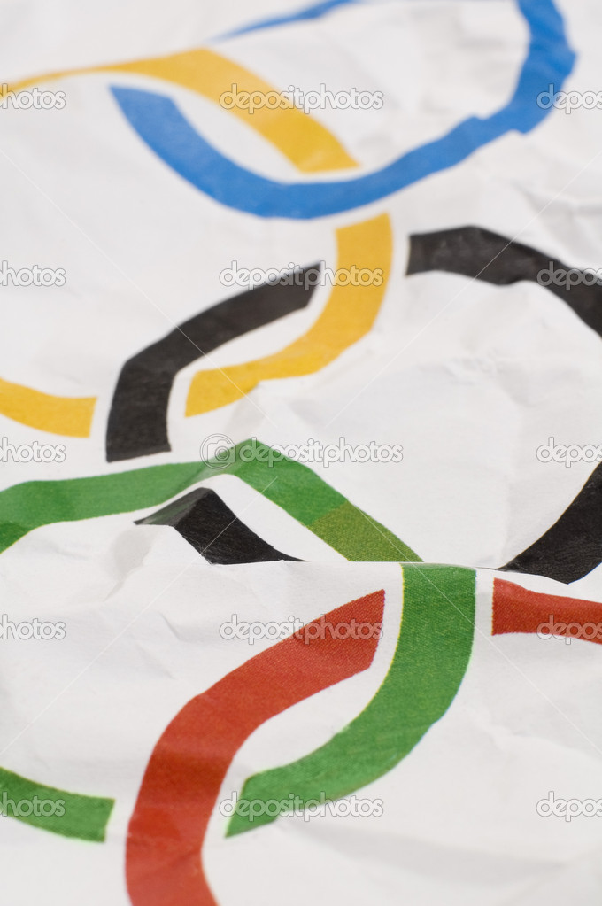 Olympic games wrinkled paper flag, vertical detail photo  Stock Photo #10142885