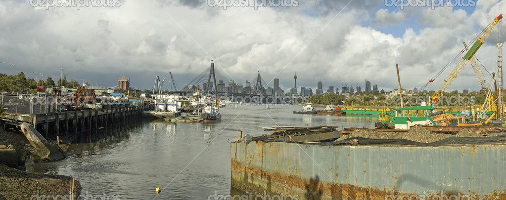Panorama photo of Sydney docks near Anzac Bridge, Sydney CBD in background  Stock Photo #10367643