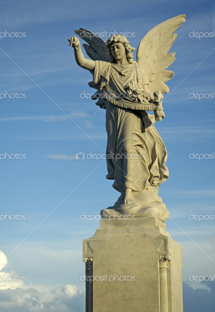 Grey angel sculpture on cloudy nice sky — Stock Photo #8227821