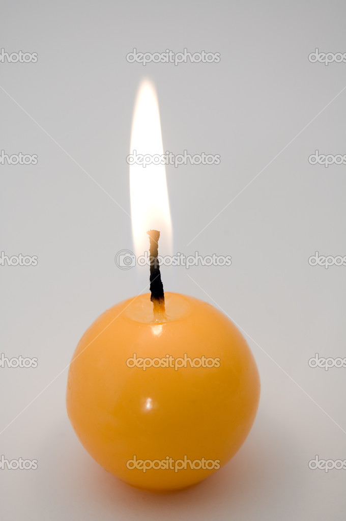Small yellow burning candle, grey background — Stock Photo #8369291