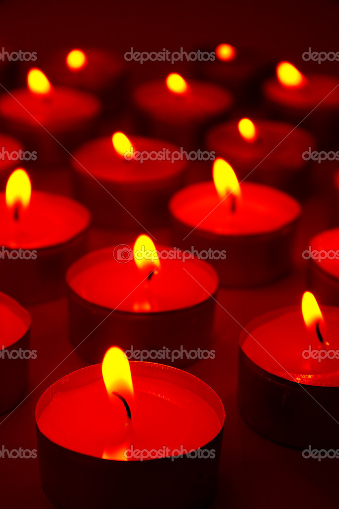 Several burning candles, distance blur, brown color  Stock Photo #8675252