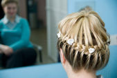 Hairdress a plait — Stock Photo