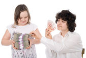 Boy takes away a batch of money from girl — Stock Photo
