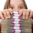 Beautiful girl and pile of money — Stock Photo
