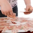 The teenager gathers money in a hand — Stock Photo