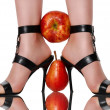 Royalty-Free Stock Photo: Fruit clamped between feet