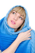 Beautiful girl with a scarf looks aside — Stock Photo