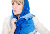 Beautiful girl with a scarf looks directly — Stock Photo