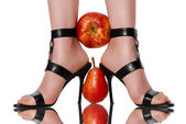 Fruit clamped between feet — Stock Photo
