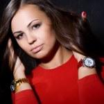 Постер, плакат: The beautiful girl with a wrist watch