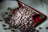 Coffee grains in a purse — Stock Photo