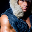 Strong athletic man in a fur cap - Stock Photo