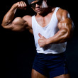 Strong athletic man in dark glasses — Stock Photo #8054860