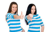 Two attractive girls show thumbs — Stock Photo