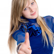 Portrait of attractive young woman showing a thumbs up — Stock Photo #9378416
