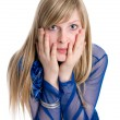 Shocked or surpised young woman with long blond hair, covering h — Stock Photo