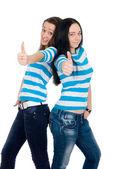 Başparmak açığa iki mutlu kız — Stok fotoğraf