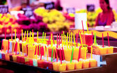 Multicolor cold fruit juices in ice, La Rambla Barcelona, La Boqueria — Stock Photo