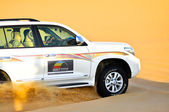 Safari car in yellow desert — Stock Photo