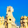 Sculpture on the top of Casa Mila by Antonio Gaudi . Panorama of the roof - Stock Photo