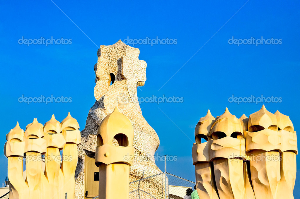 Sculpture on the top of Casa Mila by Antonio Gaudi .Panorama of the roof  Stock Photo #9399933