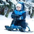 Little boy ridingsnowmobile — Stock fotografie #8251176
