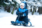 Little boy ridingsnowmobile — Stock Photo