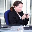Stock Photo: Private sms at Work